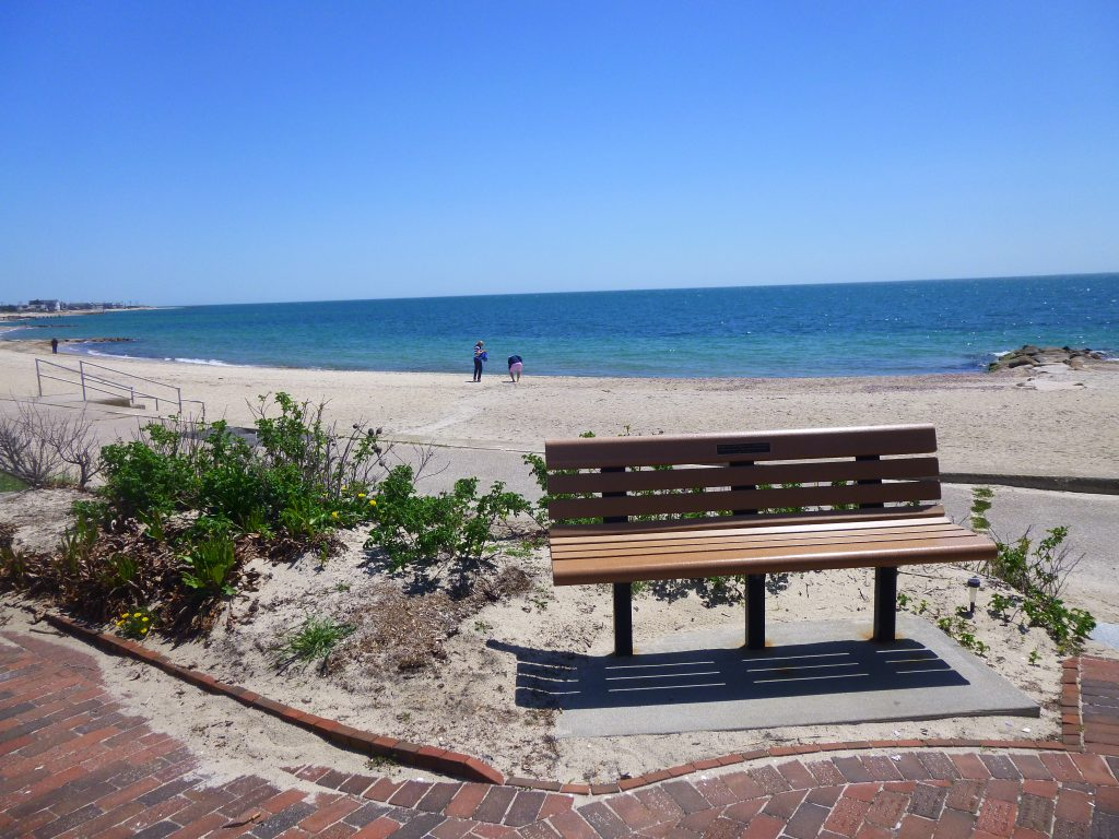 Bench and brick walkway at Falmouth Heights Beach