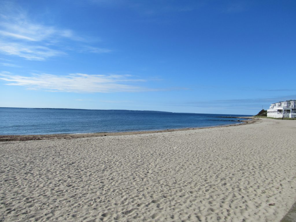 Blue sky, sand and water at Falmouth Heights Beach